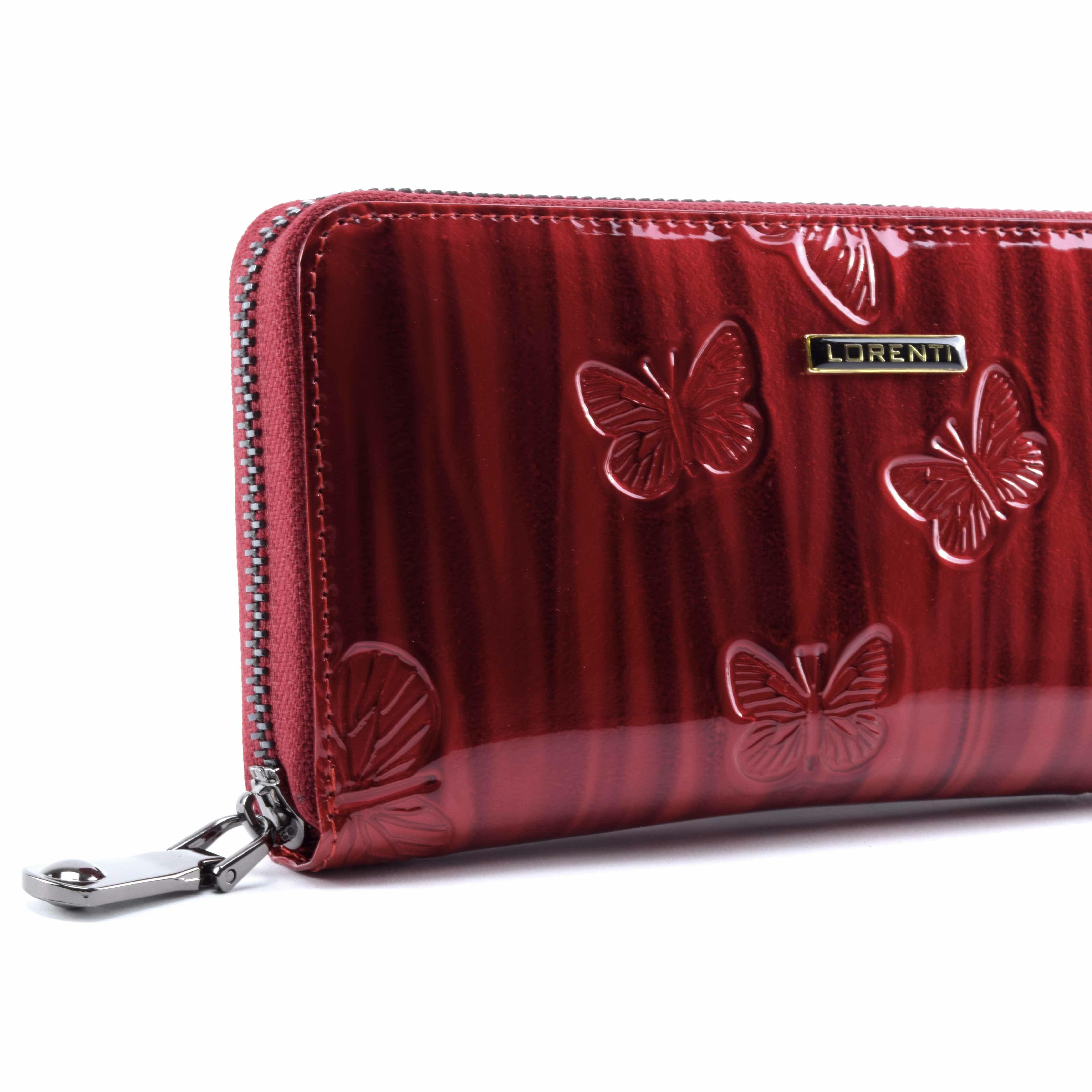 fc7b6d1aee Elegáns, pillangó mintás pénztárca. Belseje három részből áll, sok  kártyatartó és egy cipzáras zseb található benne.